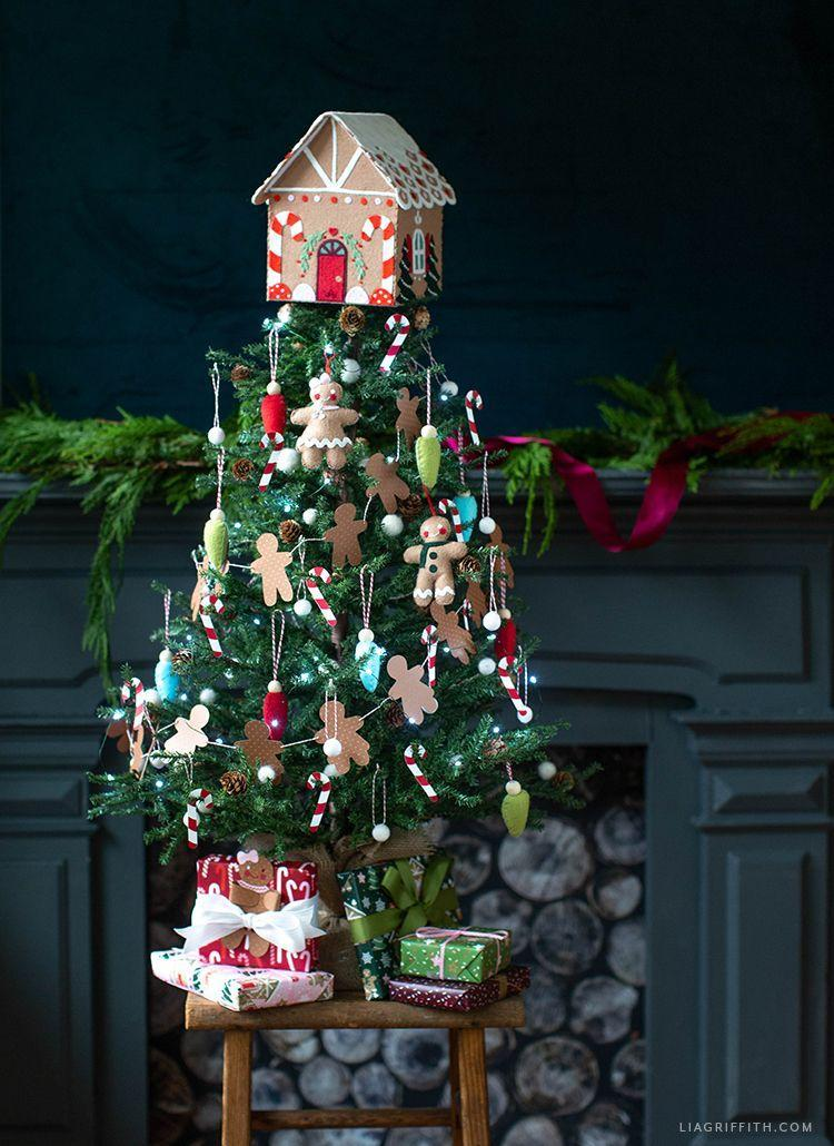 """<p>While you're turning your living room into the North Pole, keep your littles ones busy with this fun small tree to decorate with all of the gingerbreads they could possibly want. </p><p><em><strong>Get the tutorial at <a href=""""https://go.redirectingat.com?id=74968X1596630&url=https%3A%2F%2Fliagriffith.com%2Fkids-gingerbread-christmas-tree%2F&sref=https%3A%2F%2Fwww.womansday.com%2Fhome%2Fhow-to%2Fg2025%2Fchristmas-tree-decorations%2F"""" rel=""""nofollow noopener"""" target=""""_blank"""" data-ylk=""""slk:Lia Griffith"""" class=""""link rapid-noclick-resp"""">Lia Griffith</a>.</strong></em></p><p><a class=""""link rapid-noclick-resp"""" href=""""https://www.amazon.com/Nonwoven-Patchwork-Costumes-Classrooms-Parties/dp/B089VW8SR3/?tag=syn-yahoo-20&ascsubtag=%5Bartid%7C10070.g.2025%5Bsrc%7Cyahoo-us"""" rel=""""nofollow noopener"""" target=""""_blank"""" data-ylk=""""slk:BUY BROWN FELT"""">BUY BROWN FELT</a></p>"""