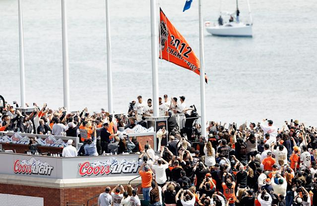 SAN FRANCISCO, CA - APRIL 05: Members of the 2012 San Francisco Giants raise the 2012 Championship Banner during a ceremony before their home opener against the St. Louis Cardinals at AT&T Park on April 5, 2013 in San Francisco, California. (Photo by Ezra Shaw/Getty Images)