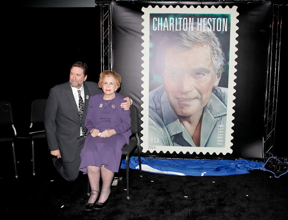 HOLLYWOOD, CA - APRIL 11:  Fraser Heston and his mother Lydia Clarke attends the first-day-of-issue dedication ceremony for the Charlton Heston Forever Stamp at TCL Chinese Theatre on April 11, 2014 in Hollywood, California.  (Photo by Tibrina Hobson/Getty Images)