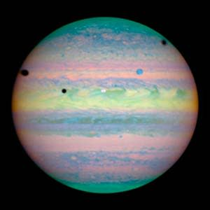 "Three moons cast shadows on Jupiter, by NASA,<a href=""http://www.spacetelescope.org/""> ESA</a>, and E. Karkoschka (University of Arizona)"