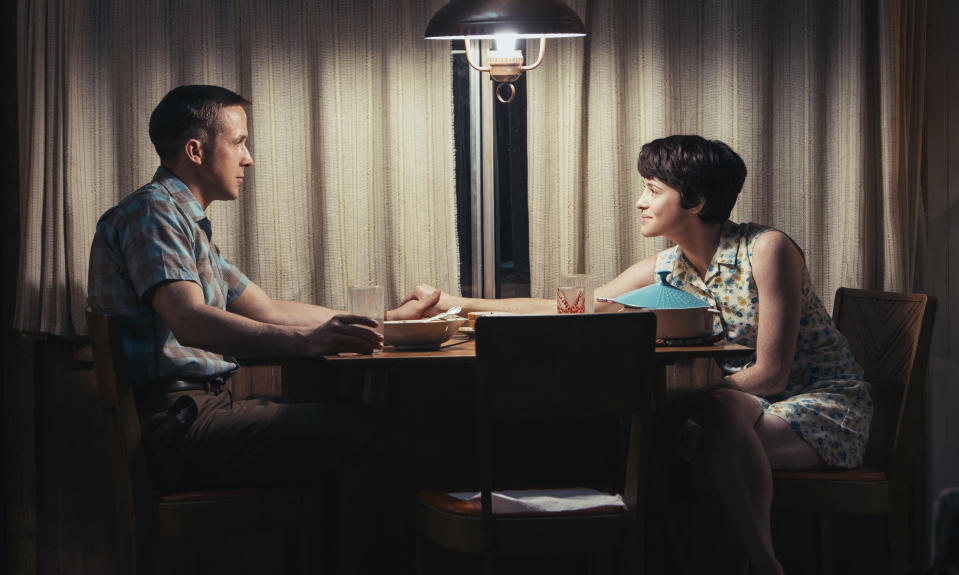"This image released by Universal Pictures shows Ryan Gosling, left, and Claire Foy in a scene from ""First Man."" (Daniel McFadden/Universal Pictures via AP)"