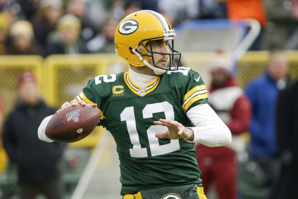 Green Bay Packers' Aaron Rodgers throws during the first half of an NFL football game against the Washington Redskins Sunday, Dec. 8, 2019, in Green Bay, Wis. (AP Photo/Mike Roemer)