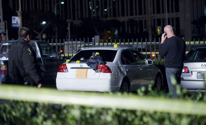 Orange County Sheriff deputies patrol at Fashion Island mall in Newport Beach Saturday, Dec. 15, 2012 after witnesses reported multiple shots being fired in one of the parking lots. Marcos Gurrola, 42, of Garden Grove was taken into custody by bicycle police officers patrolling around the mall. No one was injured. (AP Photo/The Orange County Register, Rose Palmisano) MAGS OUT; LOS ANGELES TIMES OUT