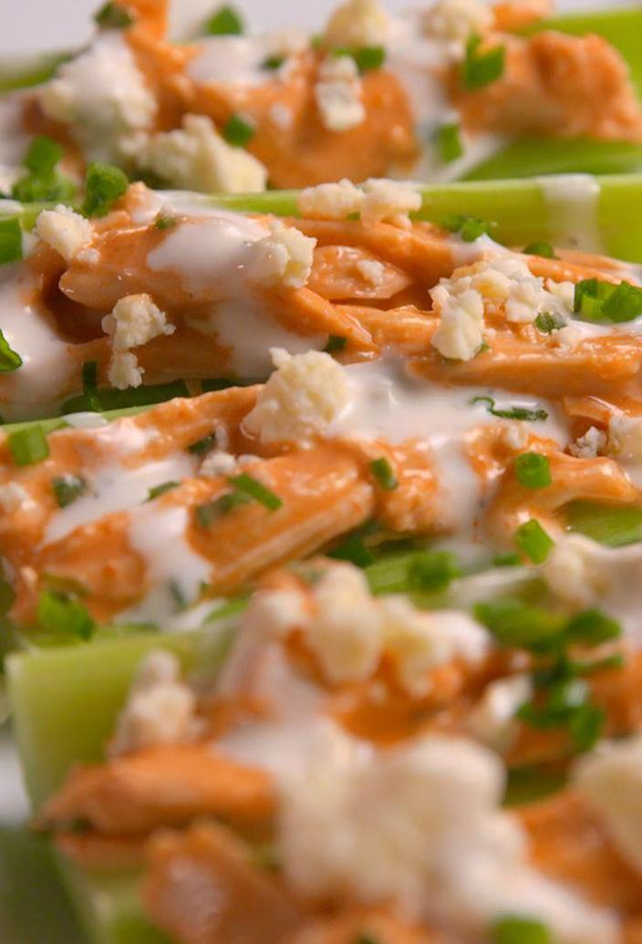 """<p>Like a whole plate of buffalo wings, in one convenient bite!</p><p>Get the recipe from <a href=""""https://www.delish.com/cooking/recipe-ideas/recipes/a53360/buffalo-chicken-celery-boats-recipe/"""" rel=""""nofollow noopener"""" target=""""_blank"""" data-ylk=""""slk:Delish"""" class=""""link rapid-noclick-resp"""">Delish</a>.</p>"""