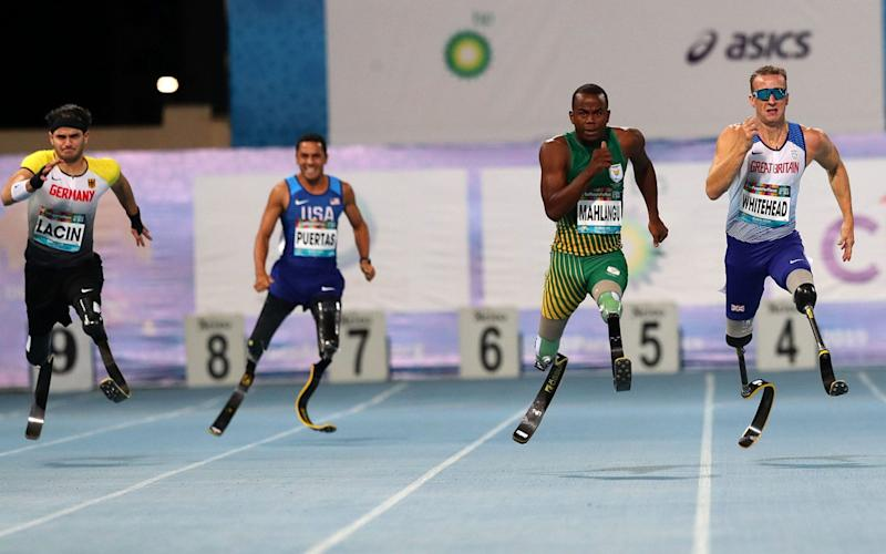Richard Whitehead, right, came second in the men's 200m T61 at the World Para Athletics Championships - REX