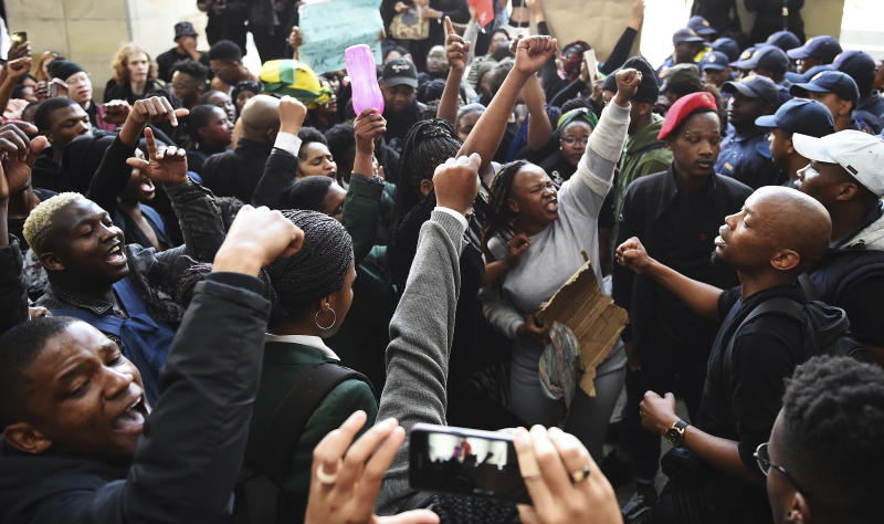 Protesters react after gaining entry to where the World Economic Forum on Africa is being held in Cape Town, South Africa, Wednesday, Sept. 4, 2019. The protesters are demanding that the government crack down on gender-based violence, following a week of brutal murders of young South African women that has shaken the nation. (AP Photo)