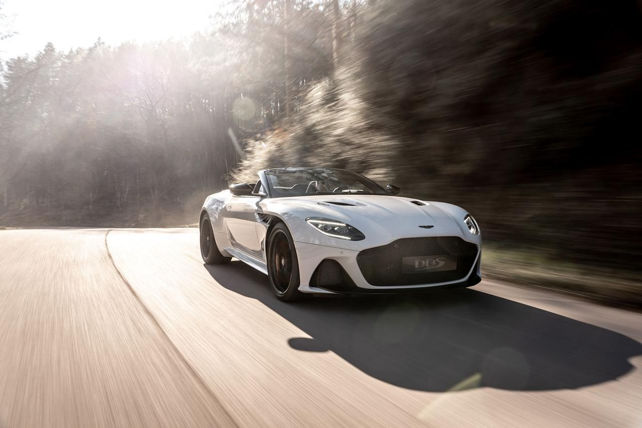 "<p>The droptop Volante shares its 715-hp twin-turbo 5.2-liter V-12 and eight-speed automatic transmission with <a href=""https://www.caranddriver.com/aston-martin/dbs-superleggera"" target=""_blank"">the DBS Superleggera coupe</a>, and the performance is nearly identical.</p>"
