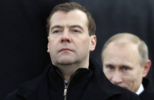 Russian President Dmitry Medvedev and Prime Minister Vladimir Putin review honour guards in Moscow. When Putin returns to the presidency on May 7, post-Soviet Russia is set to remember its only one-term president as a man whose biggest achievement was keeping the Kremlin seat warm for Putin when he was barred by the constitution from running for a third consecutive term