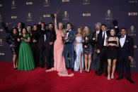 """Brett Goldstein, Hannah Waddingham, Jason Sudeikis, Juno Temple and the cast and crew from """"Ted Lasso"""" pose with their awards for outstanding supporting actor in a comedy series, outstanding supporting actress in a comedy series, outstanding lead actor in a comedy series and outstanding comedy series at the 73rd Primetime Emmy Awards on Sunday, Sept. 19, 2021, at L.A. Live in Los Angeles. (AP Photo/Chris Pizzello)"""
