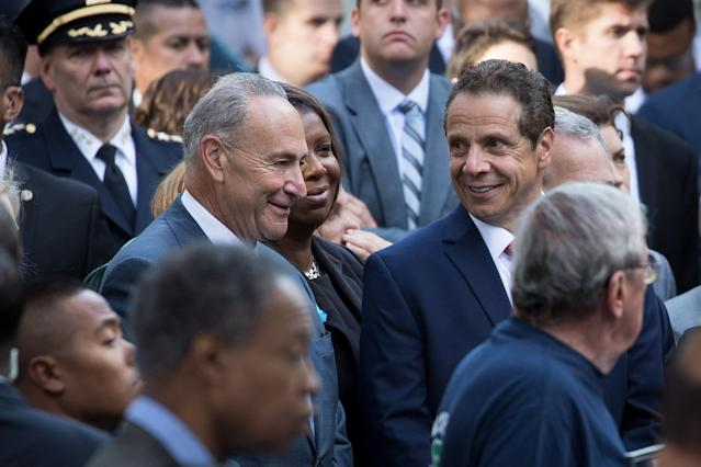 <p>Sen. Chuck Schumer, D-N.Y., speaks with New York Gov. Andrew Cuomo during a commemoration ceremony for the victims of the Sept. 11 terrorist attacks at the National September 11 Memorial, Sept, 11, 2017, in New York City. (Photo: Drew Angerer/Getty Images) </p>