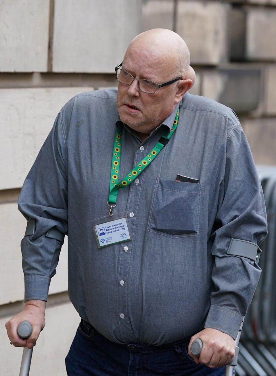 Gordon Yuill, the father of John Yuill, arriving at the High Court in Edinburgh (Andrew Milligan/PA) (PA Wire)
