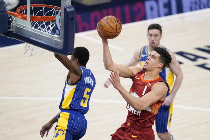 Denver Nuggets' Michael Porter Jr. (1) puts up a shot against Indiana Pacers' Edmond Sumner (5) during the second half of an NBA basketball game, Thursday, March 4, 2021, in Indianapolis. (AP Photo/Darron Cummings)