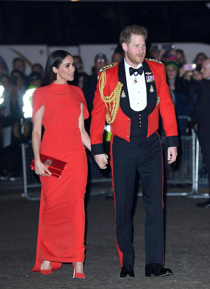 <p>Harry and Meghan don royal red garb as they attend Mountbatten Music Festival at the Royal Albert Hall in London.</p>