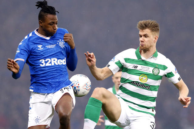 Rangers' Joe Aribo, left, and Celtic's Greg Taylor battle for the ball during the Scottish Cup Final at Hampden Park, Glasgow, Scotland, Sunday, Dec. 8, 2019. (Jeff Holmes/PA via AP)