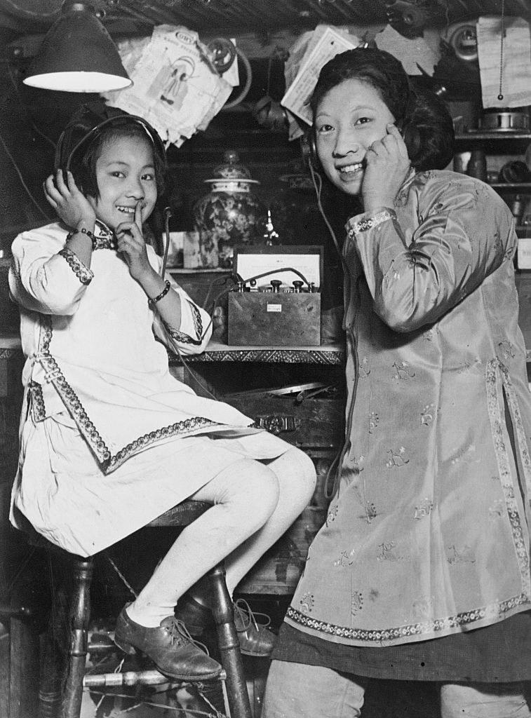 Two sisters in San Francisco's Chinatown listen to a radio together