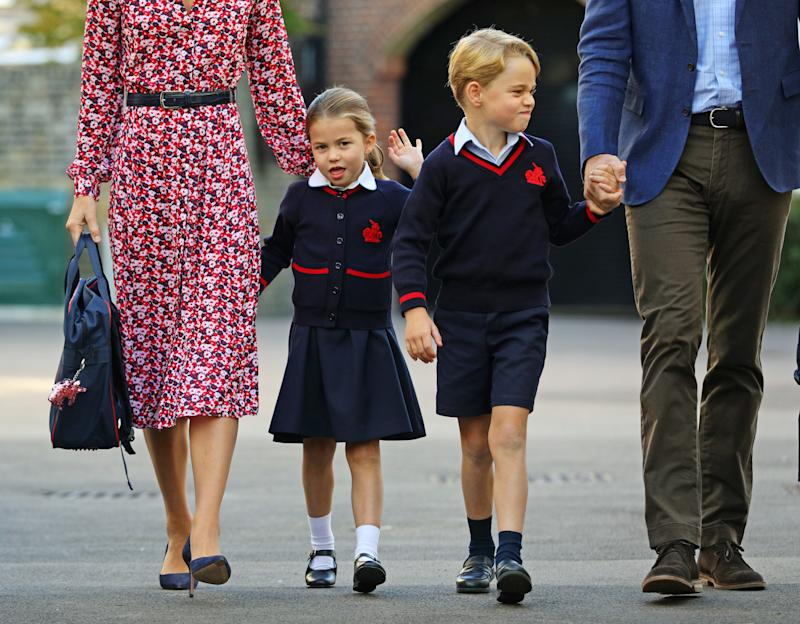 Princess Charlotte, waves as she arrives for her first day at school, with her brother Prince George and her parents the Duke and Duchess of Cambridge, at Thomas's Battersea in London on September 5, 2019 in London, England. (Photo by Aaron Chown - WPA Pool/Getty Images)