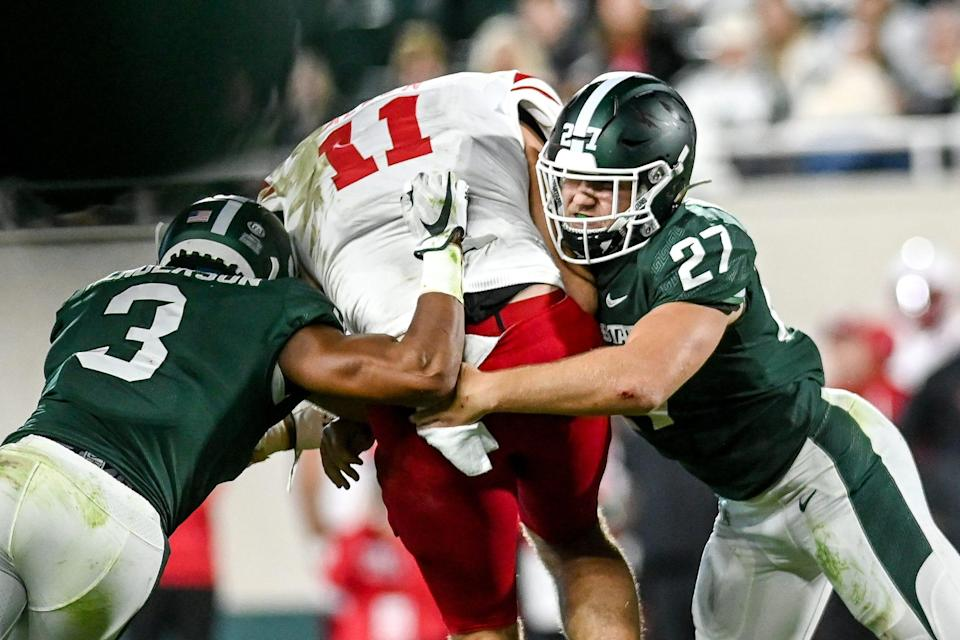 Michigan State's Cal Haladay, right, and Xavier Henderson tackle Nebraska's Austin Allen during the third quarter on Saturday, Sept. 25, 2021, at Spartan Stadium in East Lansing.