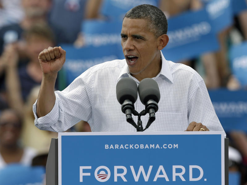 President Obama urges supporters to knock on doors to get people out to vote during a campaign rally Saturday, Sept. 8, 2012, in Seminole, Fla. (AP Photo/Chris O'Meara)