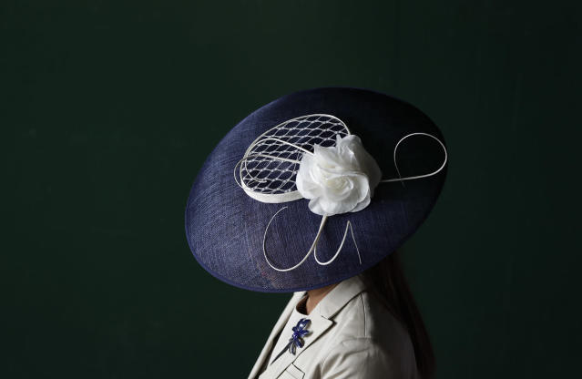 <p>A woman wears a fancy hat before the 143rd running of the Kentucky Derby horse race at Churchill Downs Saturday, May 6, 2017, in Louisville, Ky. (Photo: Matt Slocum/AP) </p>