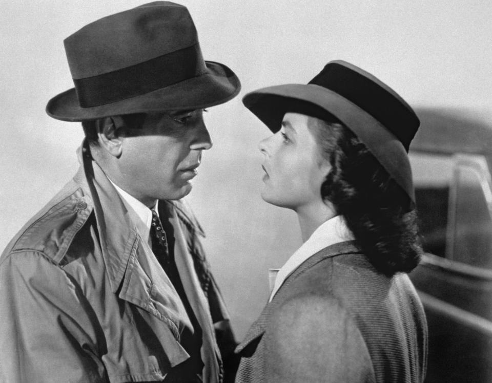 American actor Humphrey Bogart and Swedish actress Ingrid Bergman on the set of Casablanca, directed by Michael Curtiz. (Photo by Sunset Boulevard/Corbis via Getty Images)