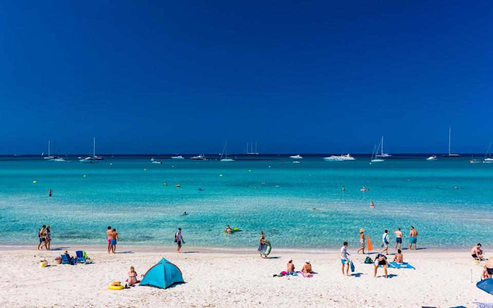 beach with a few people - iStock Editorial