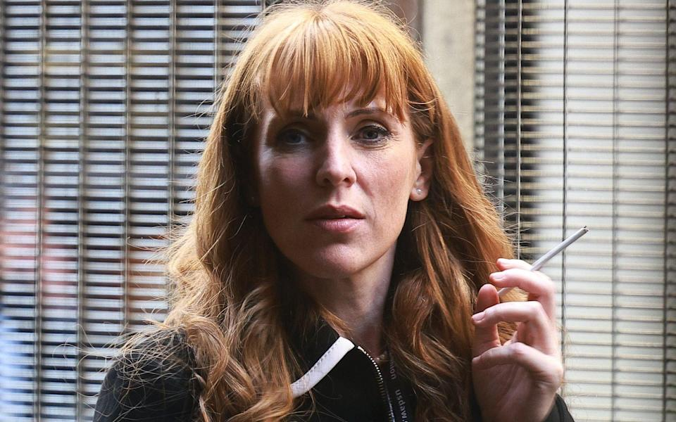 Angela Rayner, the Labour deputy leader, smokes a cigarette inside security gates at the party's conference in Brighton
