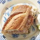"""<p>This baguette gets better with time, so let it sit for at least 10 minutes before letting your guests dive in.</p><p><em><strong><a href=""""https://www.womansday.com/food-recipes/food-drinks/a27496415/ham-and-pickle-baguette-recipe/"""" rel=""""nofollow noopener"""" target=""""_blank"""" data-ylk=""""slk:Get the Ham and Pickle Baguette recipe."""" class=""""link rapid-noclick-resp"""">Get the Ham and Pickle Baguette recipe.</a></strong></em></p>"""