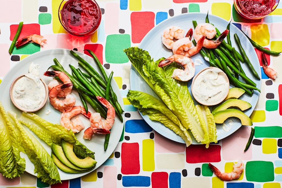 """We call this one a picnic dinner since everything can be eaten with your hands. It's easy to pack up and take to the park if you want, but it also works great on the family table. The dip is also great with any summer vegetables you've got hanging out in the fridge. <a href=""""https://www.epicurious.com/recipes/food/views/10-minute-shrimp-with-green-beans-and-creamy-lemon-dill-dip?mbid=synd_yahoo_rss"""" rel=""""nofollow noopener"""" target=""""_blank"""" data-ylk=""""slk:See recipe."""" class=""""link rapid-noclick-resp"""">See recipe.</a>"""