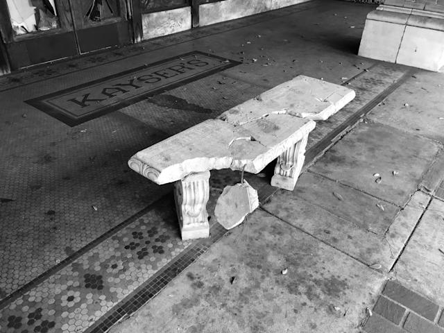 <p>A broken bench outside an abandoned store front in downtown Selma, Ala. (Photo: Holly Bailey/Yahoo News) </p>