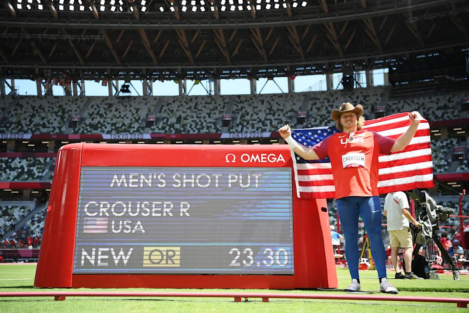 <p>Ryan Crouser of Team United States poses with a scoreboard showing his 23.30 throw for a new Olympic record in the Men's Shot Put Final on day thirteen of the Tokyo 2020 Olympic Games at Olympic Stadium on August 05, 2021 in Tokyo, Japan. (Photo by Matthias Hangst/Getty Images)</p>