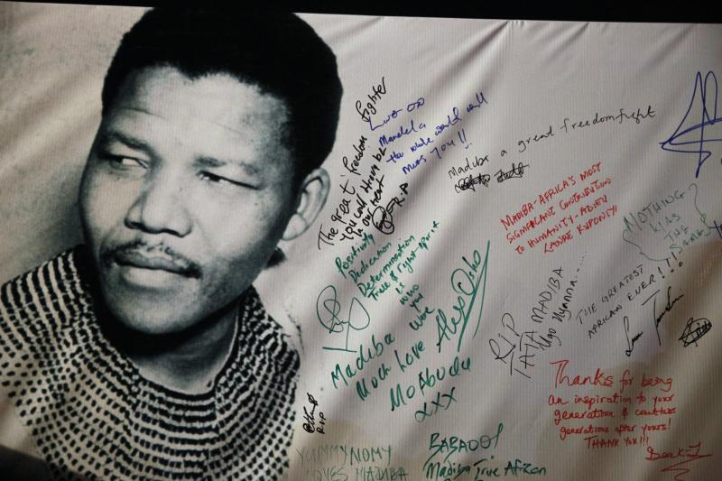 Tributes to former South African President Nelson Mandela are seen on a banner during a musical concert held in his honour in Lagos