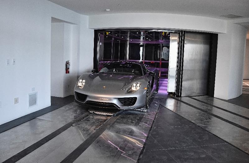 A Porsche Arrives In Condo The Automated Car Elevator Design Tower