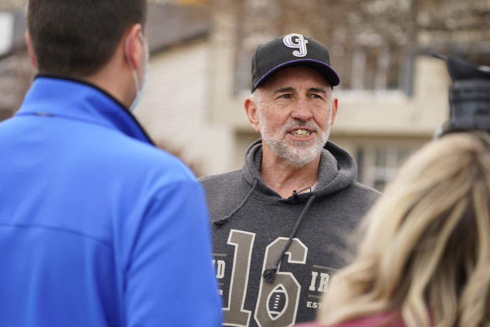 Kirby Klements talks about a piece of debris that crushed his pickup truck parked next to his home in Broomfield, Colo., as the plane shed parts while making an emergency landing at nearby Denver Internatioopnal Airport Saturday, Feb. 20, 2021. (AP Photo/David Zalubowski)