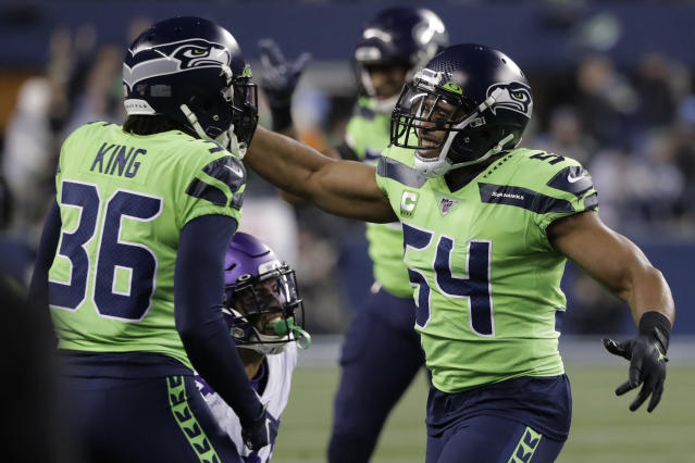 Seattle Seahawks middle linebacker Bobby Wagner, right, reacts with cornerback Akeem King (36) after the Minnesota Vikings failed to convert on a fourth-down play during the second half of an NFL football game, Monday, Dec. 2, 2019, in Seattle. The Seahawks won 37-30. (AP Photo/Ted S. Warren)