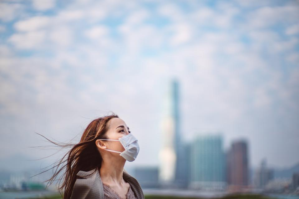 Portrait of young Asian lady with face mask to protect and prevent from the spread of viruses in the city
