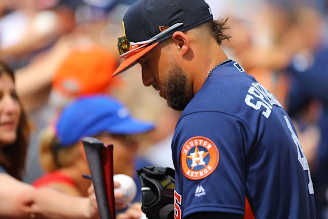 <p>Houston Astros player George Springer signs for fans before the baseball game against the New York Mets at the Ballpark of the Palm Beaches in West Palm Beach, Fla. on Feb. 26, 2018. (Photo: Gordon Donovan/Yahoo News) </p>