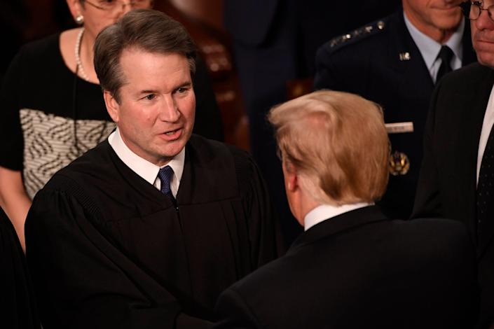 Feb 5, 2019; Washington, DC, USA;   Justice Brett Kavanaugh greets President Donald Trump before he delivers the State of the Union address from the House chamber of the United States Capitol in Washington.  Mandatory Credit: Jasper Colt-USA TODAY NETWORK (Via OlyDrop)