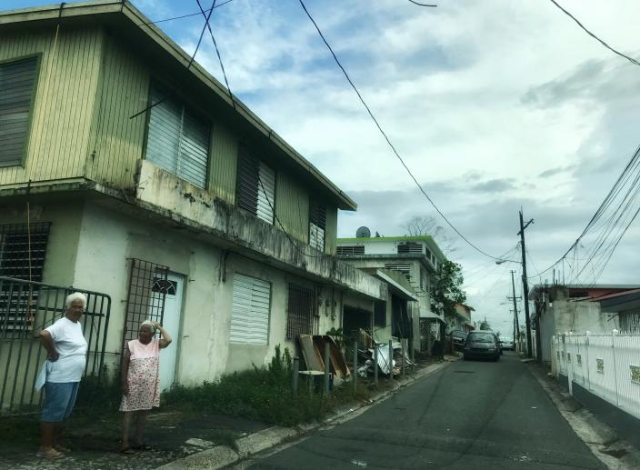 Two women stand on a residential street in Bayamón, Puerto Rico, on Oct. 7, 2017. Nearly three weeks after Hurricane Maria struck the island, Bayamón residents were still without power or electricity. (Photo: Caitlin Dickson/Yahoo News)