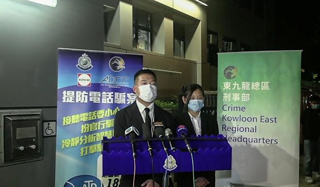 Police officers brief the media on the case of a 31-year-old local woman arrested on suspicion of fraud on Tuesday. Photo: Hong Kong Police