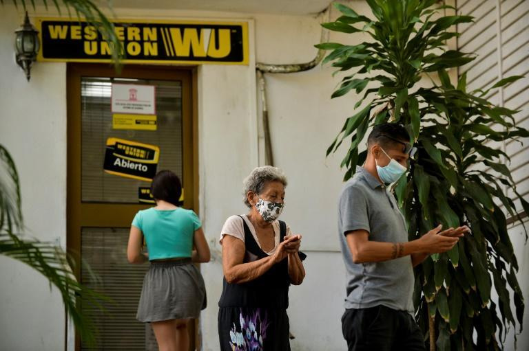 Cubans queue outside a Western Union office in Havana on October 28, 2020