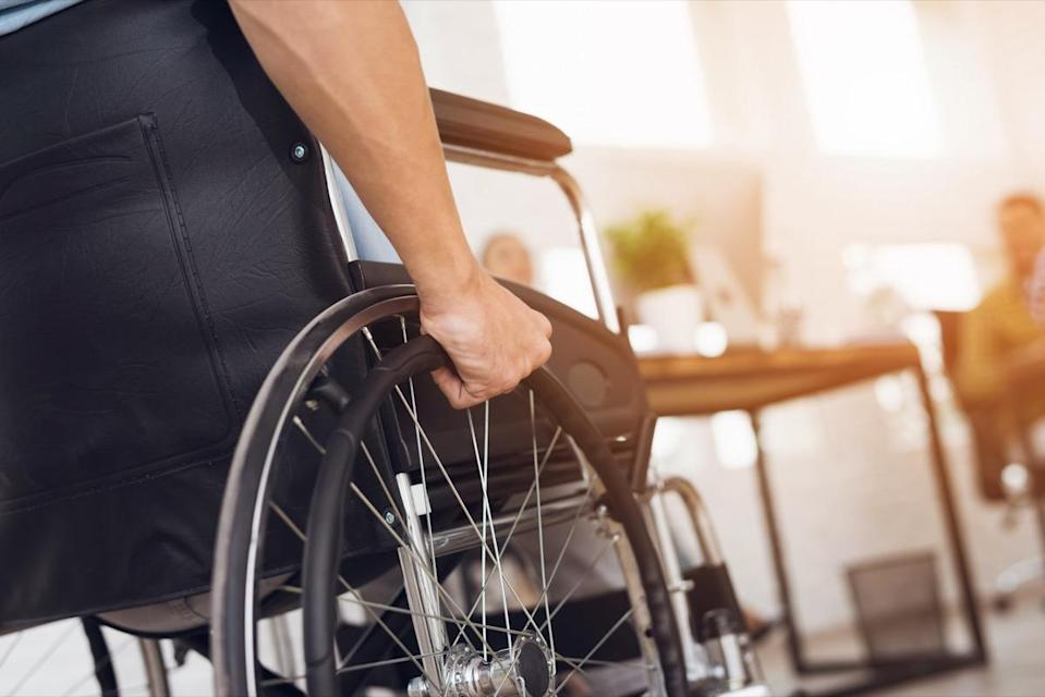 A disabled man is sitting in a wheelchair