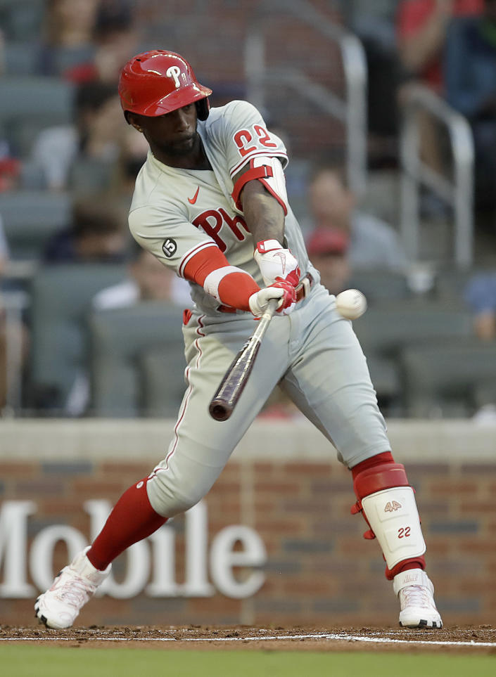 Philadelphia Phillies' Andrew McCutchen swings for an RBI-single off Atlanta Braves pitcher Ian Anderson in the second inning of a baseball game Saturday, May 8, 2021, in Atlanta. (AP Photo/Ben Margot)