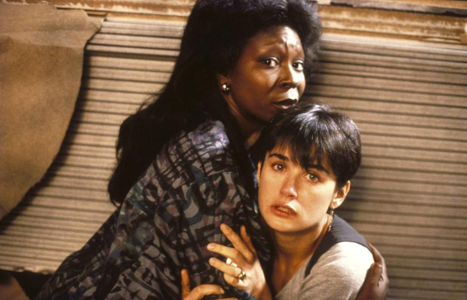 Oda Mae Brown (Whoopi Goldberg) and Molly Jensen (Demi Moore) look on as Sam Wheat (Patrick Swayze) departs for good.