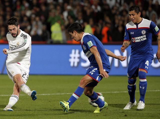 Real Madrid's Isco, left, scores during the semifinal soccer match between Real Madrid and Cruz Azul at the Club World Cup soccer tournament in Marrakech, Morocco, Tuesday, Dec. 16, 2014. (AP Photo/Christophe Ena)