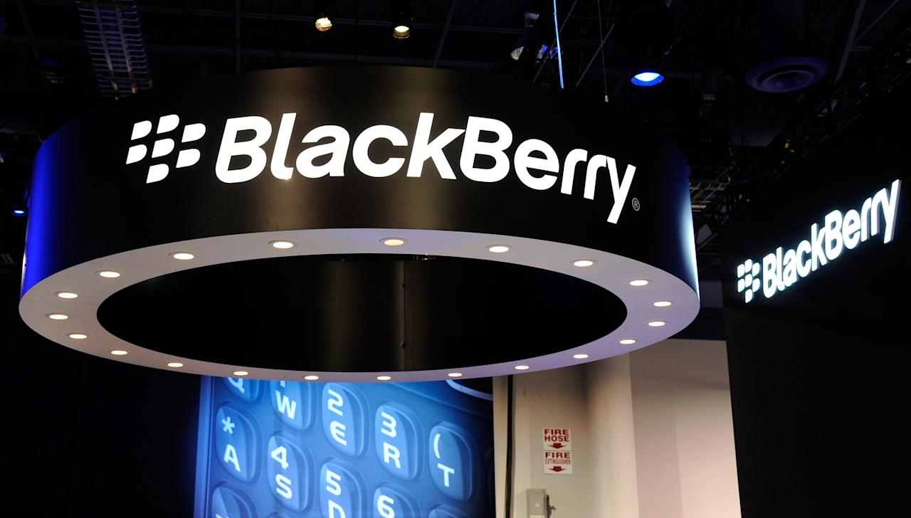 BlackBerry maker Research In Motion said Thursday it swung to a loss in its most recent quarter, in disappointing first results for the struggling device maker under its new chief executive. (AFP Photo/Ethan Miller)