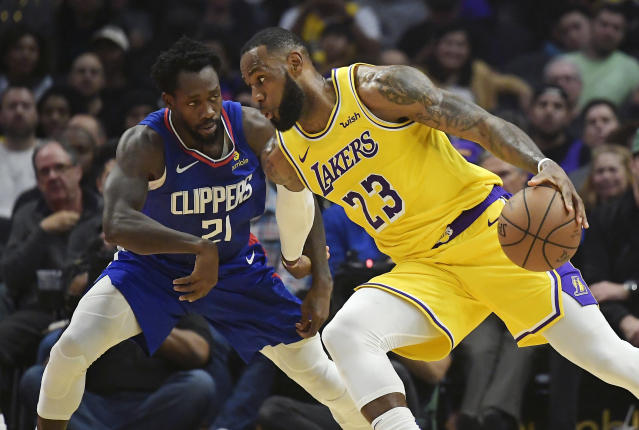LeBron James works against Clippers guard Patrick Beverley during the first half Thursday night. (AP Photo/Mark J. Terrill)