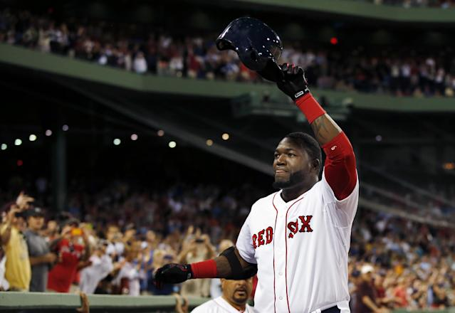 Boston Red Sox designated hitter David Ortiz comes out of the dugout and tips his helmet to the fans after hitting his second home run of the night, his 2,001st career hit, in the seventh inning of a baseball game against the Detroit Tigers at Fenway Park in Boston, Wednesday, Sept. 4, 2013. (AP Photo/Elise Amendola)