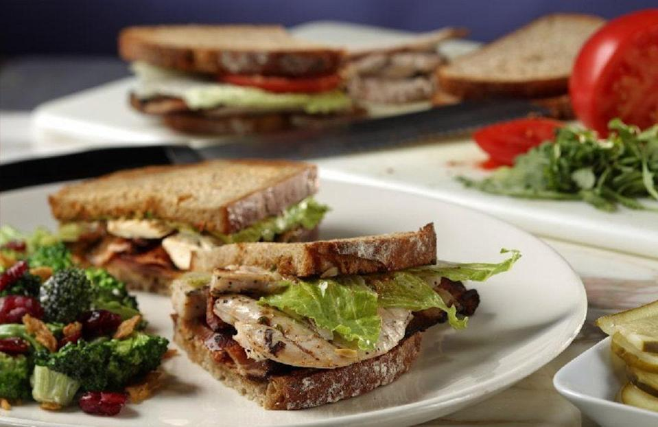 """<p>A few small tweaks to your usual chicken sandwich recipe will enhance the flavor tenfold. Here, sun dried tomato pesto gives the sammy a burst of flavor, while the bacon adds a smokiness that (when paired with roast chicken) can't be beat.</p> <p><a href=""""https://www.thedailymeal.com/best-recipes/roast-chicken-sandwich?referrer=yahoo&category=beauty_food&include_utm=1&utm_medium=referral&utm_source=yahoo&utm_campaign=feed"""" rel=""""nofollow noopener"""" target=""""_blank"""" data-ylk=""""slk:For the Perfect Roast Chicken Sandwich recipe, click here."""" class=""""link rapid-noclick-resp"""">For the Perfect Roast Chicken Sandwich recipe, click here.</a></p>"""