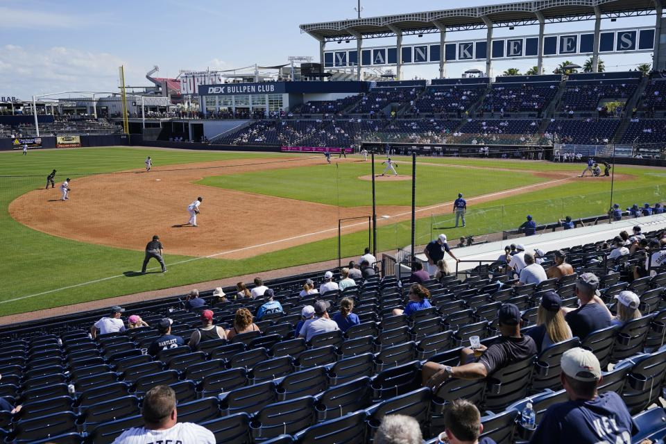 Fans watch during the fifth inning of a spring baseball game between the New York Yankees and the Toronto Blue Jays Sunday, Feb. 28, 2021, in Tampa, Fla. (AP Photo/Frank Franklin II)