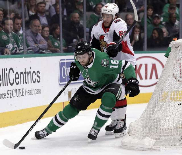 Dallas Stars center Jason Dickinson (16) controls the puck in front of Ottawa Senators left wing Mike Hoffman (68) in the first period of an NHL hockey game in Dallas, Monday, March 5, 2018. (AP Photo/Tony Gutierrez)